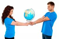Couple in love holding a globe