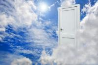 Door hanging in clouds in the sky