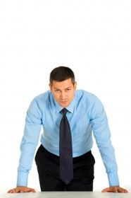 Business man leaning on desk