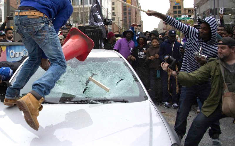 Rioters Smashing Car